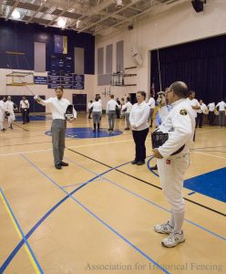 Fencers saluting the judges and directors